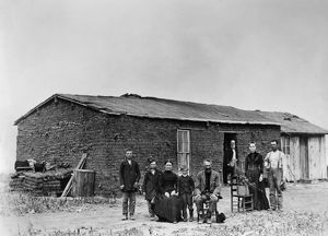 SOD HOUSE, c1880. A homesteader family in front of their sod house. Photograph, c1880