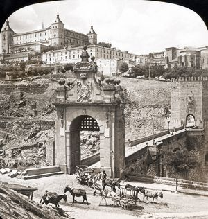 SPAIN: TOLEDO, 1908. The Bridge of Alcantara, spanning the Tagus River and the Alcazar Fortress