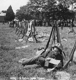 SPANISH-AMERICAN WAR, 1898. A soldier reading a letter at a camp during the Spanish-American