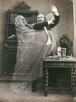 SPIRIT PHOTOGRAPH, 1863. French illusionist Henri Robin with a ghost, in a double
