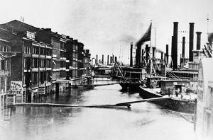 ST. LOUIS: FLOOD, 1858. A view of the Mississipi River waterfront in St. Louis