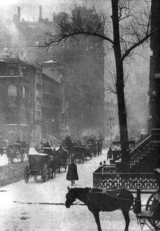 STIEGLITZ: NEW YORK, 1903. Horses and carriages on a snowy street in New York City
