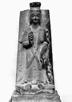 Stone relief sculpture of the bodhisattva Guanyin. Northern Wei, 386-534 A.D.