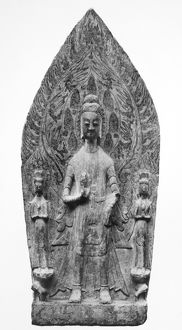 Stone stele of Buddha flanked by two Bodhisattvas. Chinese, Wei Dynasty (5th-6th century).