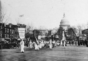 SUFFRAGE PARADE, 1913. Marchers carrying a banner reading 'Countries Where Women