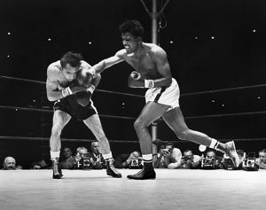 SUGAR RAY ROBINSON (1921-1989). Robinson (right) during the seventh round of a fight