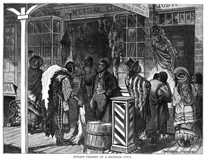 TRADING POST, 1875. Native Americans at a frontier trading post. Wood engraving