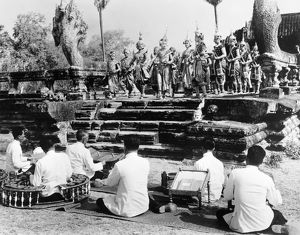 Traditional dancers and musicians performing at the ruins at Angkor, Cambodia