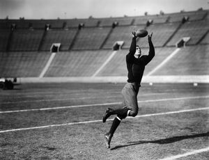 An unidentified American football player making a catch, early 20th century