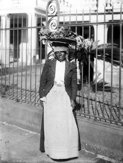 VEGETABLE VENDOR, c1900. A New Orleans woman vendor carrying her vegetables in