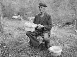 VIRGINIA: BASKET WEAVER. John Nicholson with some of the baskets that he weaves