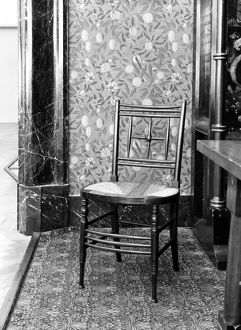WILLIAM MORRIS DESIGNS. Chair and wallpaper designed by William Morris, 1870s