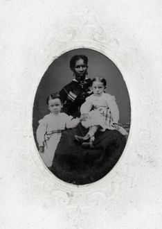 WOMAN AND CHILDREN, c1865. Portrait of an African-American woman, probably a nanny