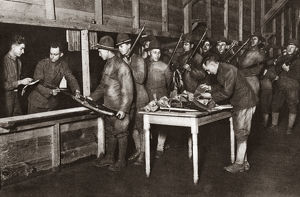 WORLD WAR I: DISCHARGE. Troops turning in their guns after being discharged at Camp Dix