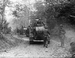 WORLD WAR I: TANK, c1917. Armored column advances down a forest road. Photograph