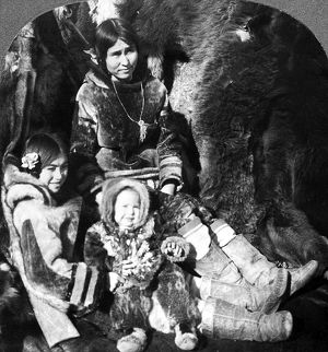 WORLD'S FAIR: ESKIMOS. An Eskimo woman and her two children participating in an