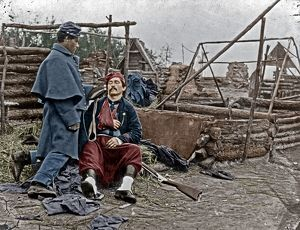 WOUNDED SOLDIER, c1865. A wounded Union soldier in a deserted camp. Photograph, c1865