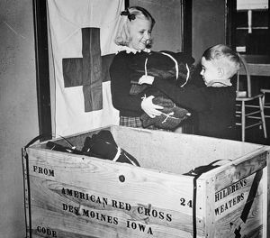 WW II: RED CROSS, c1942-43. Members of the Junior American Red Cross packing children's