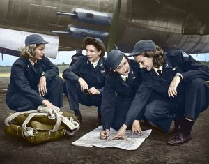 WWII: WOMEN PILOTS, c1941. Four female pilots looking at a chart. Photograph, c1941