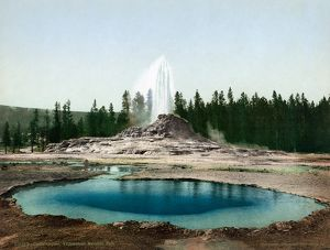 YELLOWSTONE PARK: GEYSER. View of the sinter cone Castle Geyser eruption in Yellowstone