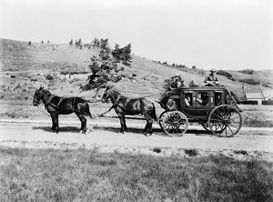 YELLOWSTONE: STAGECOACH, c1913. An old horse drawn stagecoach in Yellowstone National Park