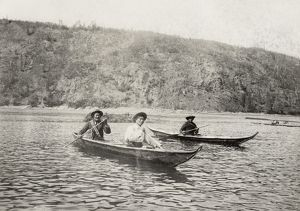 YUKON: CANOE, c1897. A Native American chief with his sons in canoes on a lake in
